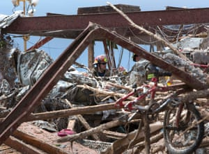 Rescue workers search through the rubble of Plaza Towers Elementary school in Moore.