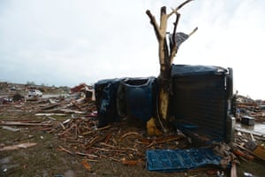 A pick up truck is wrapped around a tree in a destroyed neighborhood in Moore, Oklahoma, USA, 21 May 2013.