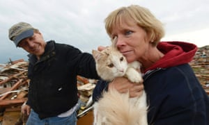 A very lucky reunion: Eric and June Simson hold their cat 'Sammi' seconds after finding it in the rubble of their home in a destroyed neighborhood. Photograph: Tannen Maury/EPA