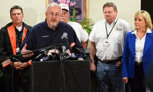 Administrator for FEMA W. Craig Fugate (C) speaks during a press conference with city officials in Moore, Oklahoma. The tornado, with winds that may have topped 200 miles (322 km) per hour, killed at least 24 people and injured hundreds more, with many of the casualties children from two schools that were destroyed.