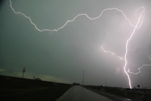 Lightning strikes over interstate 35 near Moore, Oklahoma. Thunderstorms and lightning slowed the rescue effort on Tuesday, but 101 people had been pulled from the debris alive, Oklahoma Highway Patrol spokeswoman Betsy Randolph said.