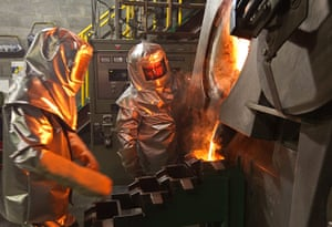WGC gallery: WGC: Workers pour molten gold from crucible