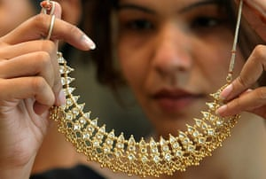 WGC gallery: WGC: Woman admires gold necklace at a jewellery store in Chandigarh
