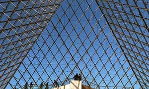 People standing in the Louvre pyramid, Paris