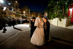 24 hours in pictures: Jeruslam: An Ultra Orthodox Jewish bride is accompanied by her relatives du