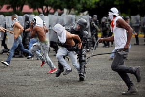 24 hours in pictures: Members of the anti riot forces of the Colombian Army