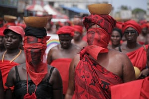 24 hours in pictures: Lome, Togo: Women wearing red, a traditional colour of mourning, march in p