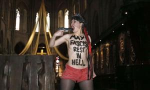 Femen feminist activist in Notre Dame, Paris
