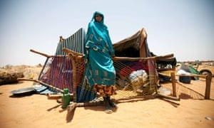 A Sudanese woman standing in front of her shelter and belongings in the Zam Zam camp for Internally Displaced Persons in North Darfur. Most of the new IDPs arrived recently from Labado and Muhajeria, East Darfur, as a result of clashes between the Sudan Liberation Army and the Government of Sudan.