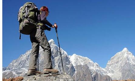 A female trekker trekking in the Everest region