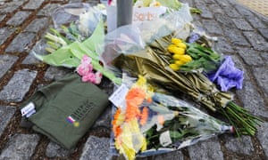 And here flowers are left close to the scene where the man died. He was wearing a Help for Heroes charity tee-shirt like the one left along with the flowers.