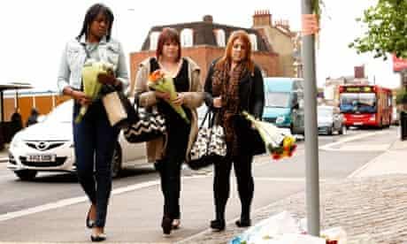 Women lay flowers near Woolwich killing
