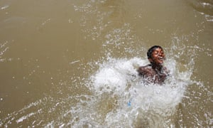 An Indian boy bathes in a canal on a hot summer day in Jammu, India. Severe heat conditions are prevailing across northern India with temperatures soaring past 45C in some places.