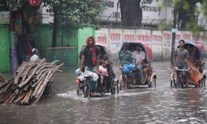 A difficult day for these Bangladeshi rickshaw drivers in the capital, Dhaka. Torrential rain has resulted in water clogging parts of the city with many roads under water.