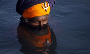 A Sikh devotee bathes in the sacred pond of the Golden Temple, the holiest of Sikh shrines on the occasion of the birth anniversary of the third Guru or the Master of the Sikhs, Sri Guru Amar Das Ji, in Amritsar, India. Born in 1479, Guru Ram Das Ji also fought the caste system and preached in favour of women's rights.
