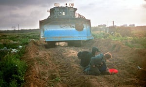 Rachel Corrie is helped after she was crushed to death by an Israeli bulldozer in the Gaza Strip