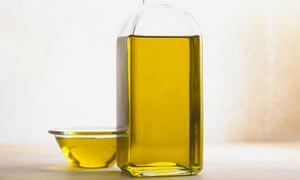 Olive oil in a bottle and bowl