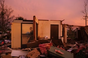 Jason Owen walks past an open door as he helps his mother to salvage items from her uncle's home after it was almost destroyed by a tornado in Moore, Oklahoma.