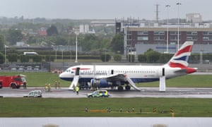 A British Airways plane is seen surrounded by emergency vehicles after it had to make an emergency landing at Heathrow airport. Both runways at Heathrow airport were closed. Heathrow said that all passengers and crew had been safely evacuated from the plane following the incident at about 9am today.