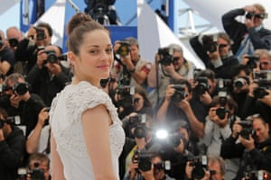 Actress Marion Cotillard poses for photographers during a photo call for the film The Immigrant at the 66th international film festival, in Cannes, southern France.