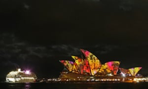"""A cruise ship navigates past the Sydney Opera House as """"Play"""" by The Spinifex Group is projected on its sails as part of Vivid Festival in Sydney. Vivid Sydney, a creative festival of light, music and ideas, runs from May 24 to June 10."""