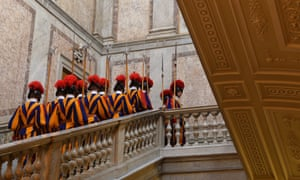Protecting popes since 1506: Swiss guards walk up stairs prior a private audience of the pontiff at the Vatican. Photograph: AFP/Getty Images