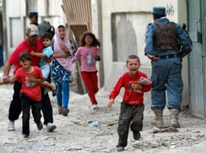 Children run away after an explosion in Kabul. Several large explosions rocked a busy area in the centre of the Afghan capital with Reuters witnesses describing shooting in the area.