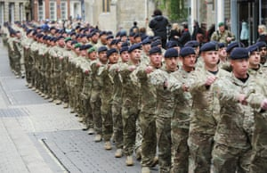 Soldiers of the British Army's 2 Signals Regiment parade marking completion of the unit's Afghanistan tour of duty, in York.