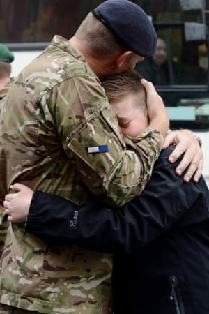 Lt Colonel Colin Vaudin, the Comanding Officer of 2 Signals Regiment greets his son Nicholas as soldiers from the regiment march through York city centre during a homecoming parade.