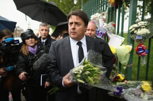 British National Party (BNP) leader Nick Griffin arrives to lay flowers close to the scene where Drummer Lee Rigby of the 2nd Battalion the Royal Regiment of Fusiliers was killed in Woolwich.