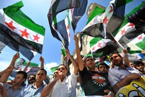 Turkish protestors wave Free Syria's flags and chant slogans during a demonstration held in front of the Fatih mosque in Istanbul.