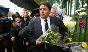 BNP leader Nick Griffin arrives to lay flowers close to the scene where Drummer Lee Rigby of the 2nd Battalion the Royal Regiment of Fusiliers was killed, on 24 May 2013.