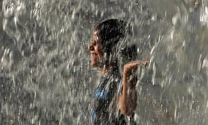 An Indian child plays in water to cool off, at a water theme park during a hot summer afternoon in Hyderabad. The region continues to reel under extreme heat wave conditions with the mercury reaching 44 degrees Celsius.