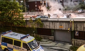 Cars burning in Husby as rioting spread to several cities in Sweden last week.