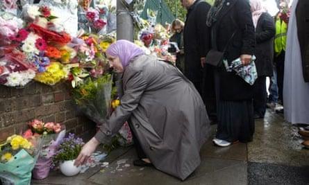 Members of Muslim groups at the memorial site for British soldier Lee Rigby.