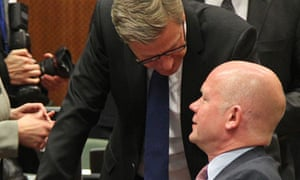 William Hague talks to Guido Westerwelle during the EU foreign ministers meeting in Brussels