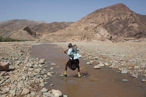FTA: Siegfried Modola : An armed Afar man crosses a river near the Danakil Depression