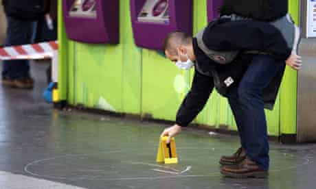 Policeman at the scene where a man stabbed a French soldier at a train station in La Defénse, Paris