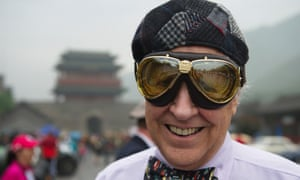 A be-goggled participant smiles as the 2013 Peking-to-Paris Motor Challenge, one of the world's longest and toughest classic car rallies, kicks off at the foot of the Great Wall in Beijing, China. About 96 classic and vintage cars from 26 countries set off from the Great Wall to drive the 7,767-mile route from Beijing to Paris in 33 days