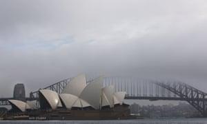 Australia's Sydney Harbour Bridge and Opera House are enveloped in early morning fog
