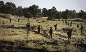 Israeli infantry soldiers take part in unit exercises in the Israeli-annexed Golan Heights near the border with Syria.