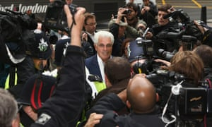 Publicist Max Clifford is mobbed by the press as he arrives at Westminster magistrates court to face 11 charges of indecent assault, allegedly committed between 1966 and 1985