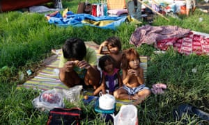 Filipino children sit in a makeshift shelter during the ongoing clean-up of clogged waterways in a slum area of Manila. Torrential rains could result in massive flooding in the capital