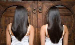 Rear view of sisters at a wooden door