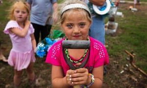 Zoey Eslin poses for a portrait while helping repair a family member's grave damaged by the tornado in Moore, Oklahoma.