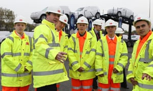 The Chancellor of the Exchequer George Osborne talks to workers at The Port of Liverpool during a visit to mark the start the beginning of the dredging of the River Mersey Estuary. The Chancellor has a month of announced spending cuts and today announced he is about 20% of the way there. Read more on the story.