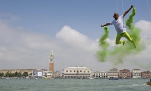 Chinese artist Li Wei performs in front of Saint's Mark as part of the 55th International Art Exhibition in Venice, Italy.