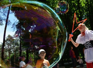 A boy looks at soap bubbles during the Share Drive of Life charity event organized by the Kiev Chapter Ukraine motorcycling club for children with autism in a park in Kiev. The number of children with various forms of autism in Ukraine increased over the past five years .