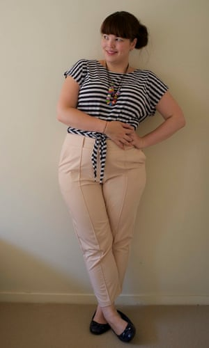 Blogger wearing pale pink cropped pants with ballet flats and a navy and white striped tee.