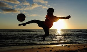 Children of the NCB Sports Academy enjoy a game of football at the Mauritius Resort in Port Louis.